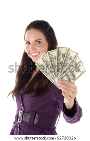 Smiling female with pile of dollar banknotes (isolated) (focus on hand) - stock photo