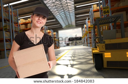 Smiling female worker in a distribution warehouse - stock photo