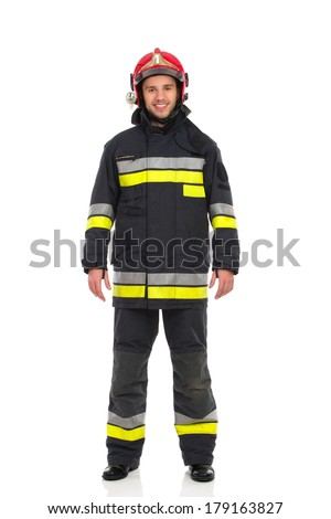 Smiling firefighter posing, front view. Full length studio shot isolated on white. - stock photo