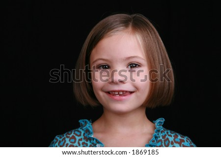 smiling five year old survivor of fetal alcohol syndrome - stock photo