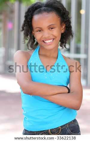 Smiling, friendly, african american teenager girl, portrait - stock photo