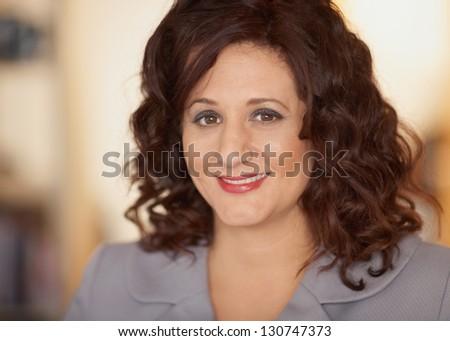 Smiling friendly businesswoman closeup portrait at office - stock photo