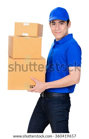 Smiling friendly delivery man carrying parcel boxes on white background - stock photo