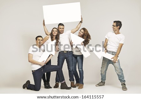 Smiling friends with empty boards - stock photo