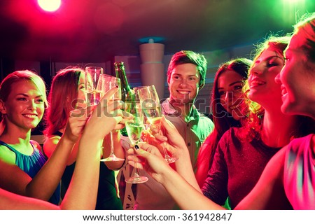 smiling friends with wine glasses and beer in club - stock photo
