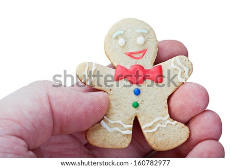 Smiling gingerbread men in a hand isolated on white background - stock photo