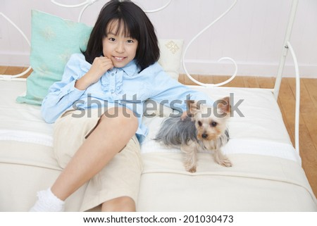 smiling girl and Yorkshire Terrier - stock photo