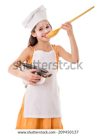 Smiling girl as cook tasting from the ladle with pot in hand, isolated on white - stock photo