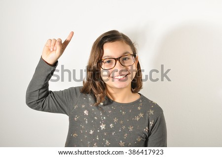 Smiling girl asking permission.  - stock photo