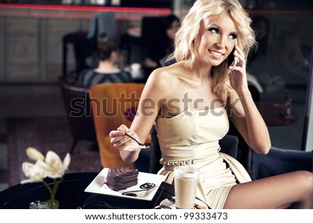 Smiling girl at the cafe - stock photo