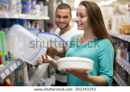 smiling girl buying pails in the shopping mall  - stock photo