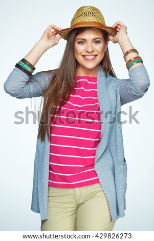 Smiling Girl hipster style portrait on white background. Yellow straw hat. Isolated. - stock photo