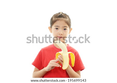 Smiling girl holding banana - stock photo