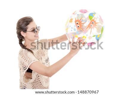 Smiling girl holding beach ball - stock photo