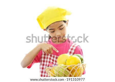 Smiling girl holding fruits - stock photo