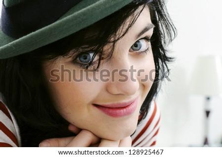smiling girl in green hat - stock photo