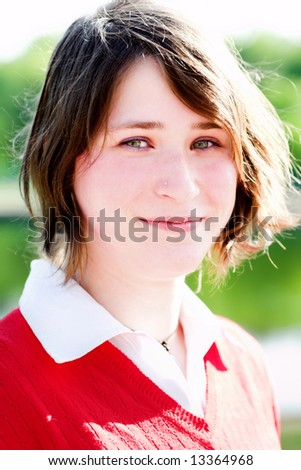 Smiling girl in red portrait outdoor - stock photo
