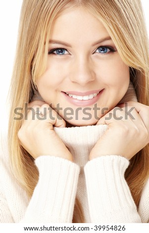 Smiling girl in the white sweater, isolated - stock photo