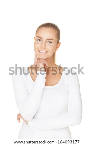 Smiling girl in white t-shirt on isolated white - stock photo