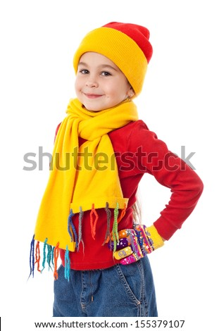 Smiling girl in winter clothes, isolated on white - stock photo