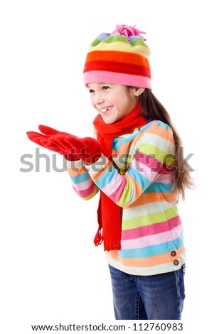 Smiling girl in winter clothes with empty hands, isolated on white - stock photo