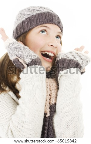 Smiling girl in winter style, enjoying the snow - stock photo
