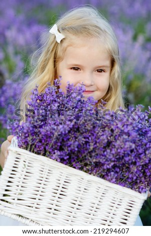Smiling girl is in a lavender field - stock photo