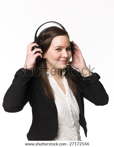 Smiling girl listen to music - stock photo