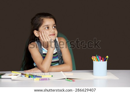 Smiling girl lost in thoughts - stock photo