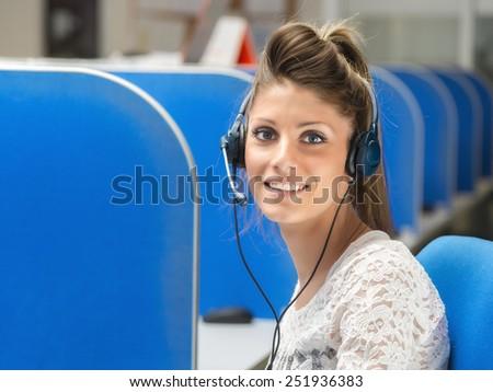 smiling girl operator in call center - stock photo