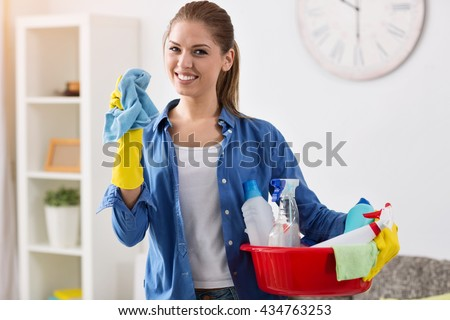 Smiling girl ready for cleaning, mopping time - stock photo