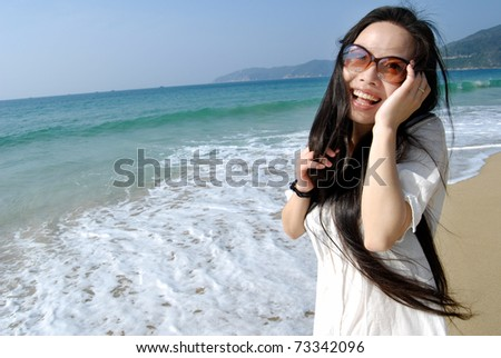 smiling girl relaxing on tropical beach - stock photo