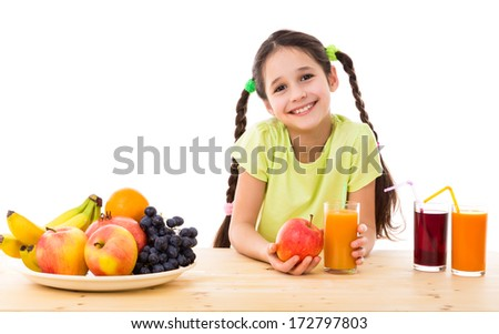 Smiling girl sitting on the table with fruits and juice, isolated on white - stock photo