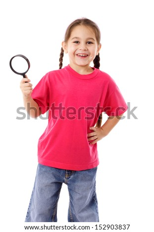 Smiling girl standing with magnifying glass, isolated on white - stock photo