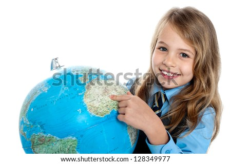 Smiling girl student pointing at something over the globe. - stock photo