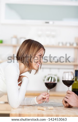 Smiling girl toast with a glass of red wine - stock photo
