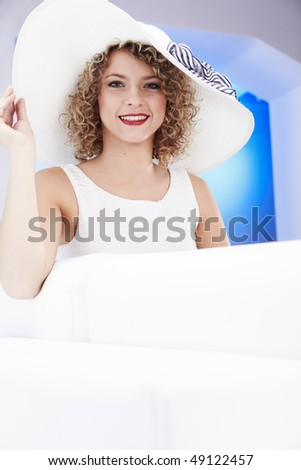 Smiling girl wearing a white hat - stock photo
