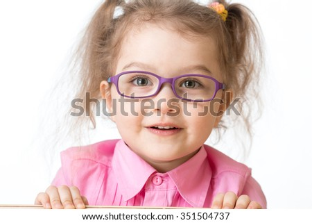 Smiling girl wearing glasses closeup portrait isolated - stock photo