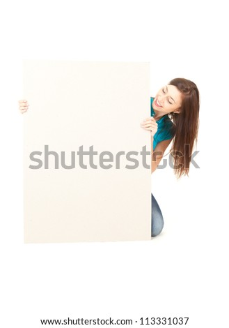 smiling girl with blank sign, white background - stock photo