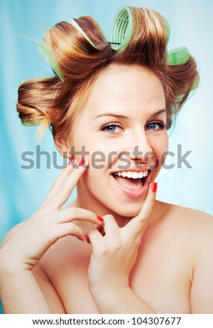Smiling girl with curlers - stock photo