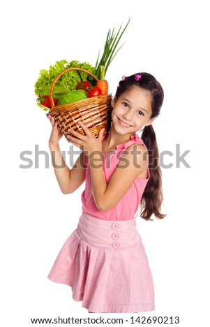 Smiling girl with fresh vegetables in basket, isolated on white - stock photo