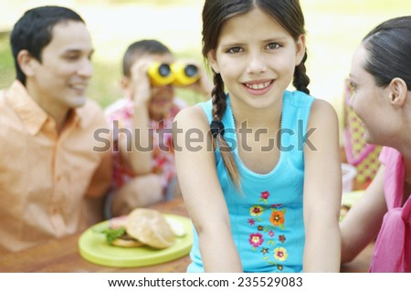 Smiling Girl with Her Family - stock photo