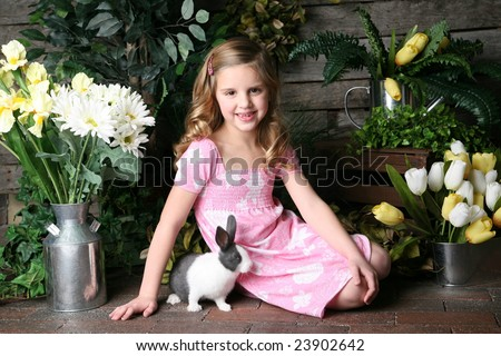 Smiling Girl with Rabbit - stock photo