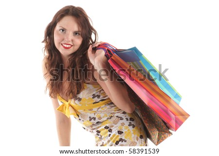 Smiling girl with shopping bags - stock photo