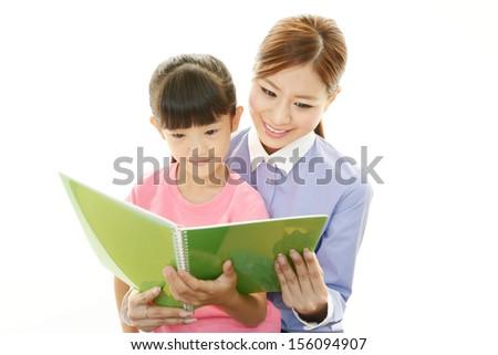 Smiling girl with teacher - stock photo