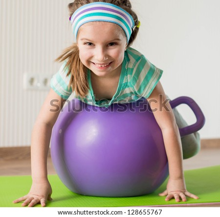 smiling  girl with the fitness ball   at home - stock photo