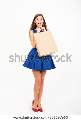 Smiling girl with the shopping bag  - stock photo