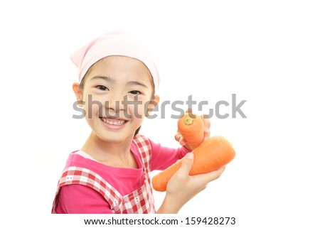 Smiling girl with vegetables - stock photo