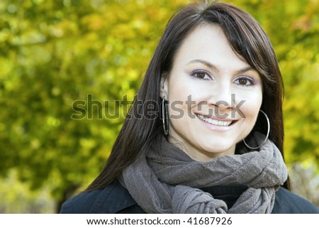 Smiling girls in the colorful park. - stock photo