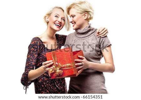 Smiling girls opening gift - stock photo